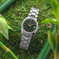 Green-dialed stainless steel wristwatch with gold-tone indexes and hands.