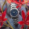 Stainless steel wristwatch with a blue textured dial.