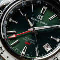 Grand Seiko SBGJ239 - macro detail of green dial with red accents.