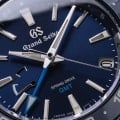 Grand Seiko SBGE255- macro of blue dial with light blue accents.