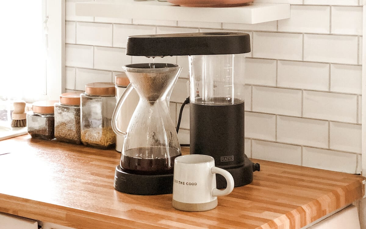 The glass carafe and Kone being used to brew coffee.