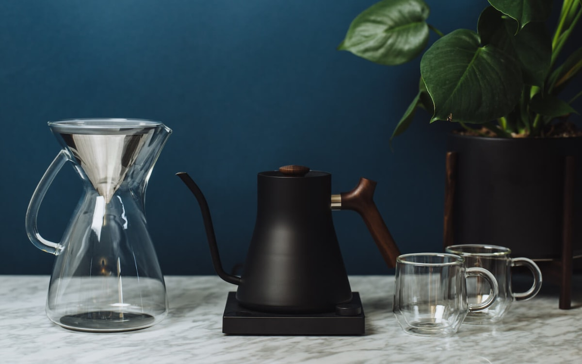 The glass carafe and Kone pictured with an electric kettle.