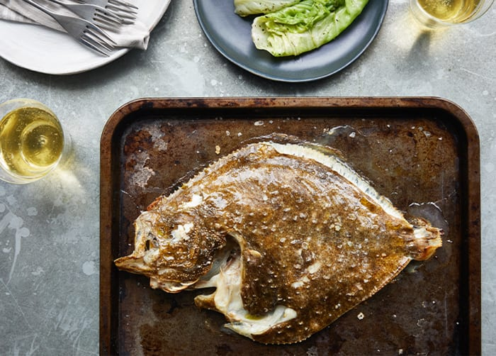 Whole Grilled Turbot in Seaweed Butter with Spring Greens recipe image